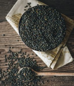dried blue green lentils in a cast iron pot