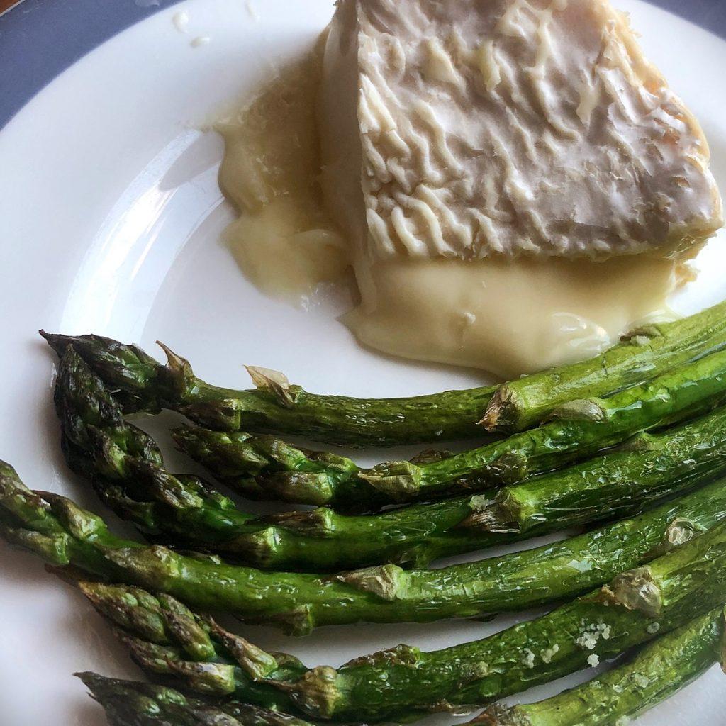 Melting Tunworth with roasted asparagus